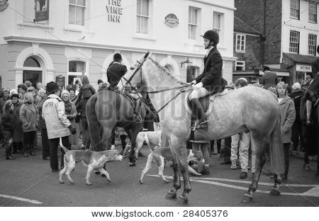 TENTERDEN, ENGLAND - DECEMBER 26: The Ashford Valley Hunt assemble for their Boxing Day meet in the High Street on December 26, 1992 in Tenterden, Kent. Fox hunting was outlawed in England in 2004.