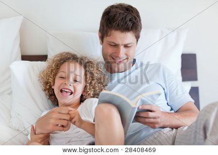 Father reading bedtime story for his child