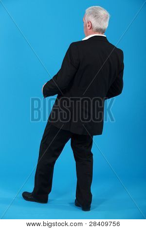 Businessman leaning backwards