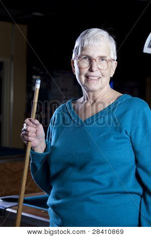 Senior With A Pool Cue