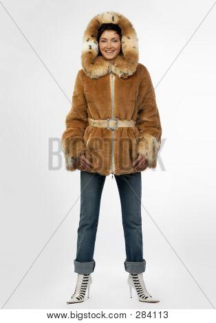 Beautiful Young Woman In A Fur Coat.