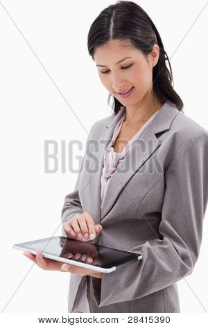 Businesswoman using tablet against a white background