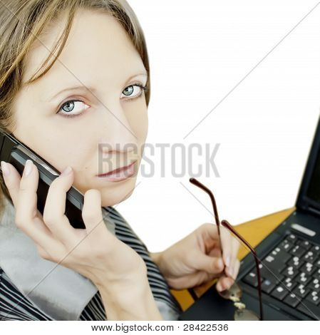 Business woman sitting at the table