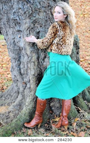 fashion model wearing fake fur animal print short jacket