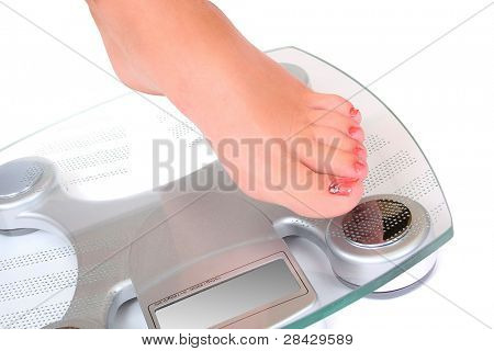 Foot on a bathroom scale - Isolated