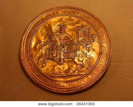 Old gold coin in vatican museum - Rome Italy