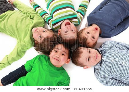 Young boys lying on floor isolated on white background