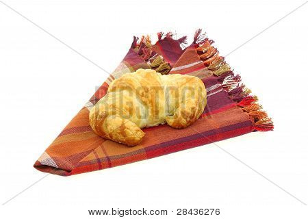 Croissant On Folded Plaid Napkin