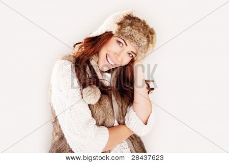 Beautiful laughing fashion model wearing winter fur garments, upper body studio portrait on white