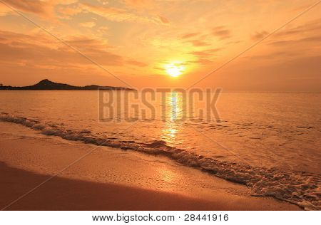 Sunrise landscape on ocean beach - water waves, sun, sky. Thailand, Koh Samui