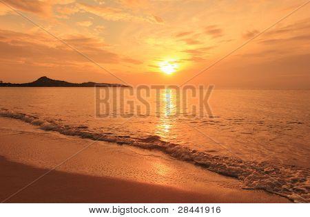 Sunrise landscape on ocean beach - water waves, sun, sky. Thailand, Koh Samui