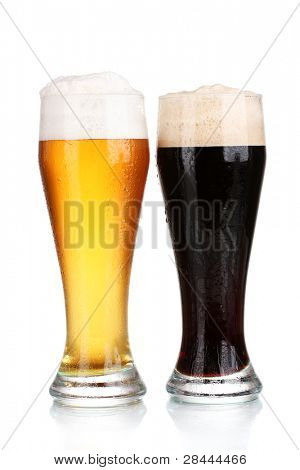 black and golden beer in glasses isolated on white