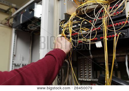 Telecom Engineer Connecting Fiber Optic