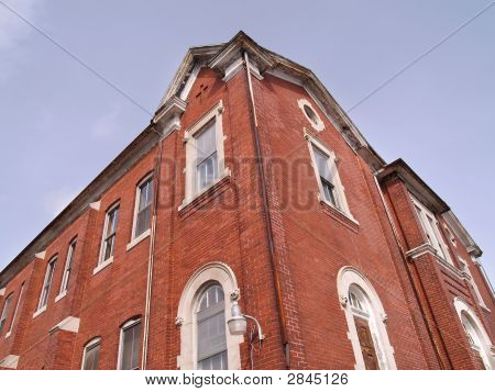 Looking Up At An Old Red Brick Building