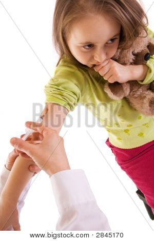 Little Girl Receiving An Injection - Studio Shot - Isolated