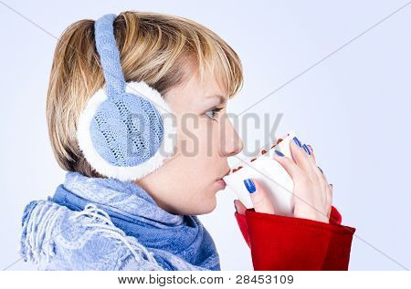 Blond Girl Dressed In Winter Clothes Drinks A Tea