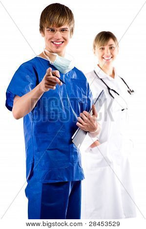 Surgeon And Nurse Over White Background