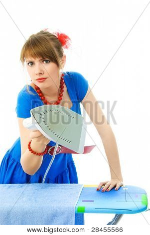 aggressive young housewife ironing the towel against white background
