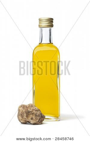 Bottle of olive oil with fresh white truffle on white background