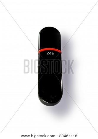 Black Usb Flash Drive With A Red Stripe In The Center And The Words