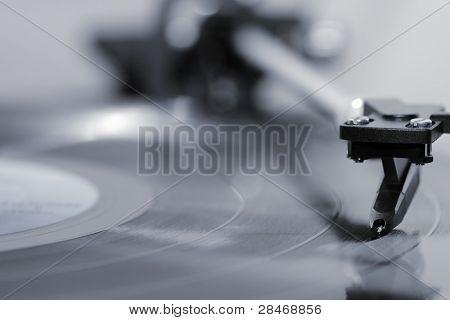 Stylus on a vinyl LP record.