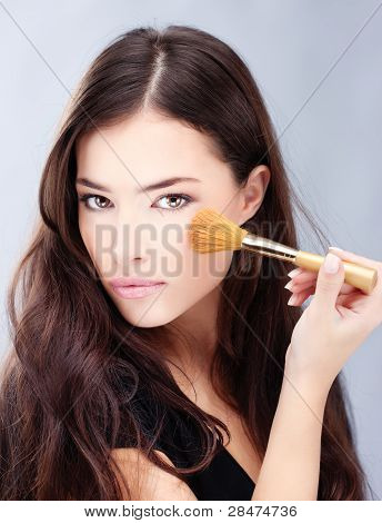 Woman Holding Powder Brush