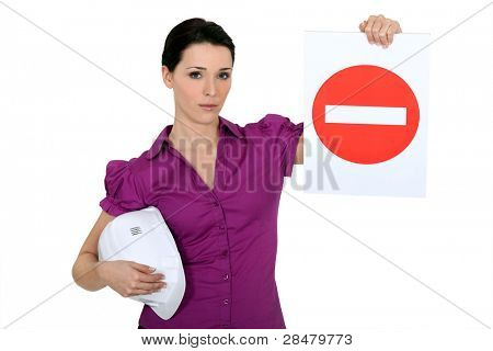 Woman holding a no entry sign