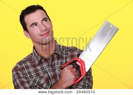 Smiling man with a tenon saw