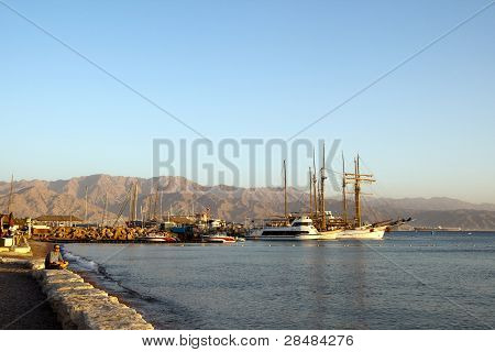 EILAT, ISRAEL - DECEMBER 12, 2011 - View On The Bay, Illuminated By The Rays Of The Setting Sun.