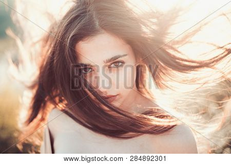 poster of Girl With Nude Shoulders Enjoy Her Hair Waving By Wind. Hair Care Concept.woman On Calm Face Enjoy S