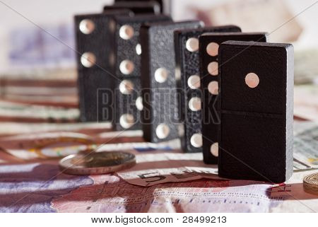Standing Dominoes On Bank Notes