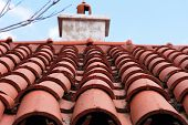 Red Tiled Roof. Penthouse, Top Floor. Blue Sky poster