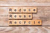 Reduce, Reuse And Recycle Word Written On Wood Block. Reduce, Reuse And Recycle Text On Wooden Table poster