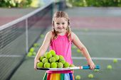 Child Playing Tennis On Outdoor Court. poster