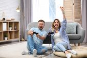 Young Couple Playing Video Game At Home poster