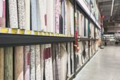 Blurred Background. Shelves With A Large Selection Of Roll Of Wallpaper In The Store. Colorful Rolls poster