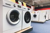 Washing Machines Are In The Household Appliance Store. Choosing And Buying Washing Machines In The E poster