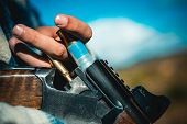 Hunting Licenses. Hunter With Shotgun Gun On Hunt. Hunter In The Fall Hunting Season. Man Is Chargin poster