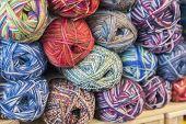 Knitting Needles, Colorful Threads. Knitting Pattern Of Colorful Yarn Wool On Shopfront. Knitting Ba poster