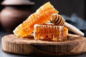 Honeycomb And Wooden Honey Dipper. Raw Honey. Natural Honey, Closeup View poster