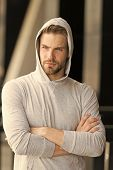Cool And Confident. Man Unshaven Hooded Folded Arms Looks Handsome And Cool. Guy Bearded Attractive  poster