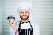 Chefs Dish. Man Cook Hat And Apron Hold Meal Covered With Lid. Delicious Meal Presentation. Haute Cu poster