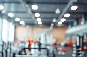 Fitness Gym Background.focus On The Bench And Blurred Gym Equipment poster