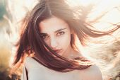 Girl With Nude Shoulders Enjoy Her Hair Waving By Wind. Hair Care Concept.woman On Calm Face Enjoy S poster