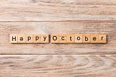 Happy October Word Written On Wood Block. Happy October Text On Table, Concept poster