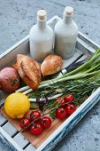 wooden box with fresh produce, fresh bread and olive oil poster