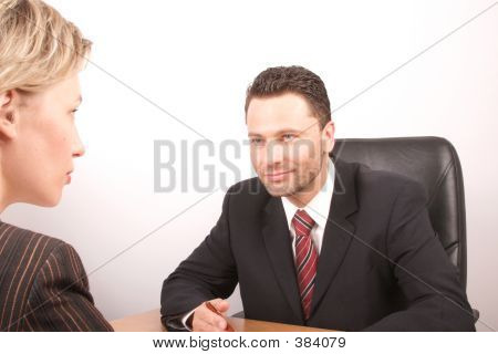 White Business Man And Woman Talking