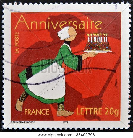 FRANCE - CIRCA 2006: stamp printed in France shows woman with cake circa 2006