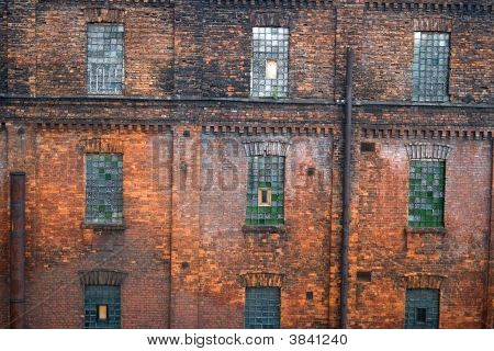Red Brick Wall With Mosaic Windows