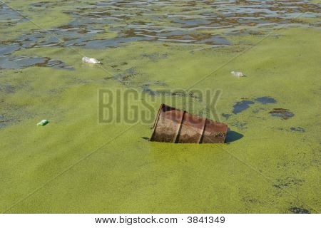 Metal Barrel Floating In River